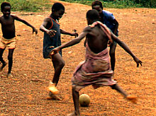 chilcren playing soccer in Ghana