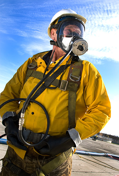 man in respirator industrial photography