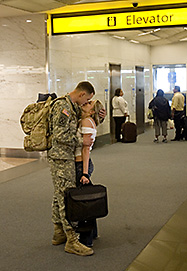 Iraq war soldier kisses girlfriend goodby in airport